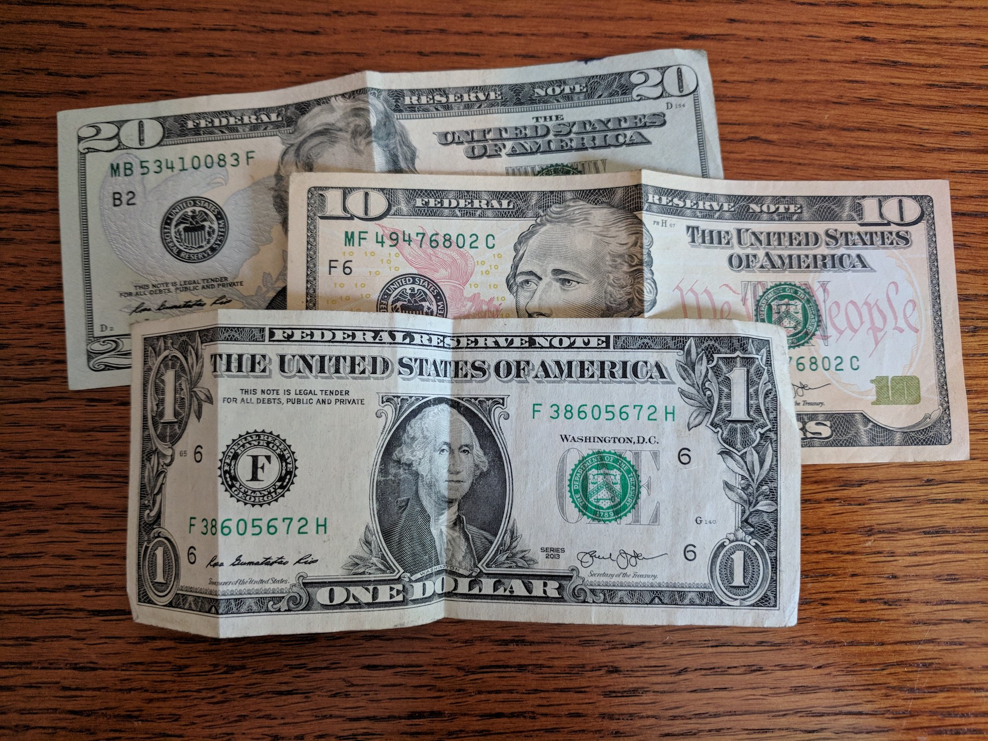 A 20, 10, and 1 dollar bill